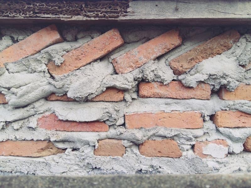 Die Backsteinmauer ist in Form rechteckig lizenzfreies stockfoto
