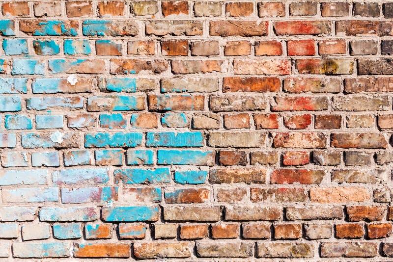 Die Beschaffenheit der Backsteinmauer, gemalt mit alter Farbe stockfoto
