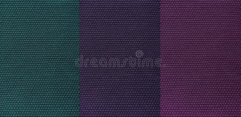 Die Beschaffenheit der gestrickten Dunkelheit des woolen Gewebes ungewöhnlicher abstrakter Hintergrund lizenzfreies stockbild
