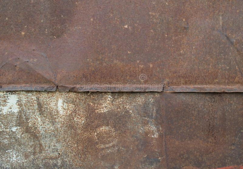 Die Beschaffenheit der Metallwand Rost, rotes, gebrochenes Eisen lizenzfreies stockbild