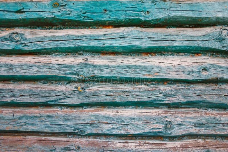 Die Beschaffenheit der Türkiswand der Klotz des alten Hauses lizenzfreies stockfoto