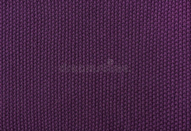 Die Beschaffenheit des gestrickten Purpurs des woolen Gewebes lizenzfreie stockfotos