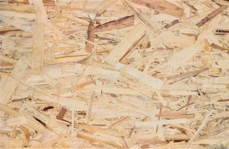 Die Beschaffenheit des hölzernen Sägemehls, helles Holz stockfotos