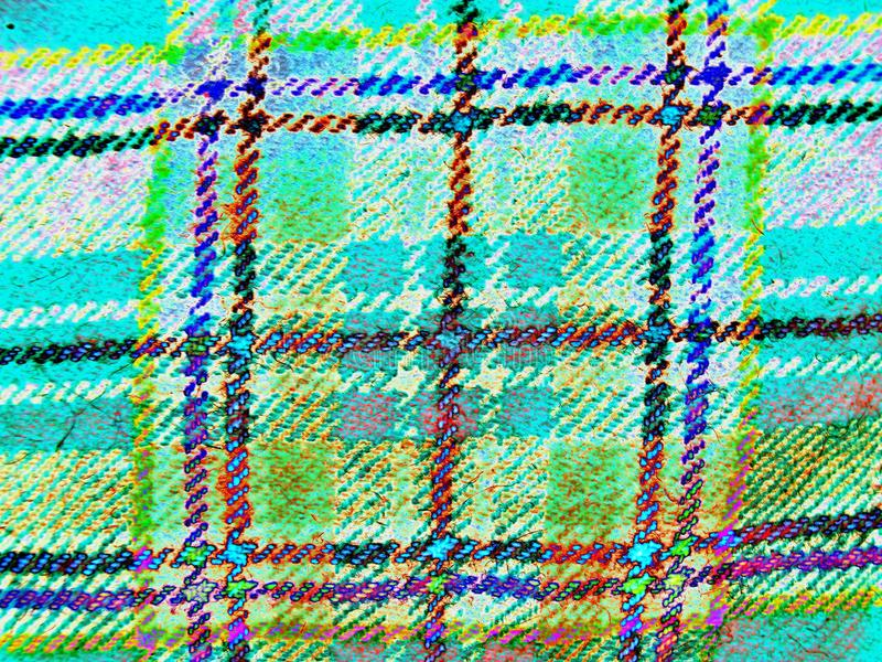 Die Beschaffenheit des schottischen Gewebes in der Zelle Neon, negativ lizenzfreie stockfotos