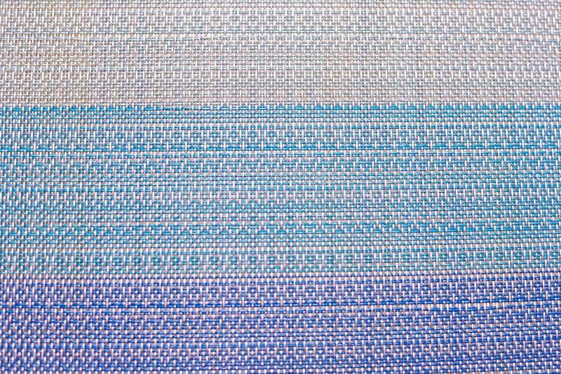 Die Beschaffenheit eines mehrfarbigen gesponnenen Teppichs stockfoto