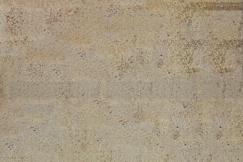 Die Beschaffenheiten des Gipses, unter dem ein Ziegelstein ist Strukturiertes Graues des Hintergrundes und braun stockfotos