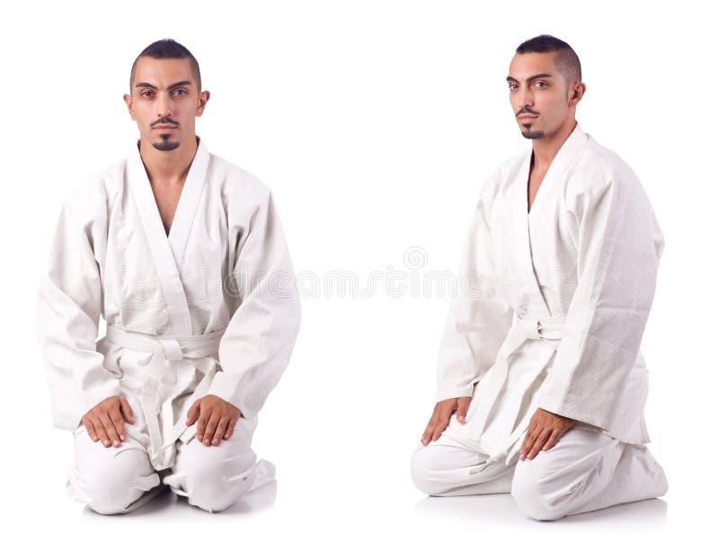 Die Collage des Karatespielers im Kimono lokalisiert auf Weiß stockbilder