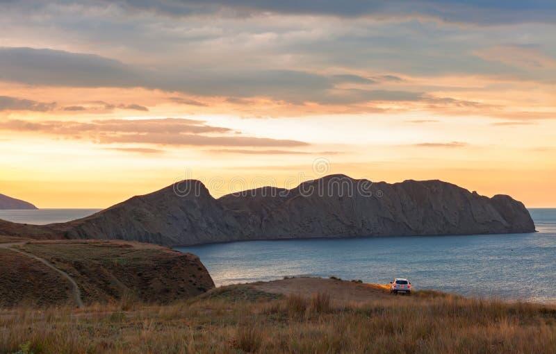 Die Dämmerungssonne über dem Kap-Chamäleon in der Krim-Halbinsel stockbilder
