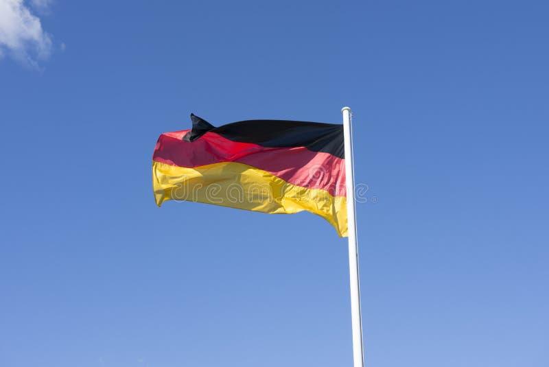 Die deutsche Flagge lizenzfreie stockfotos