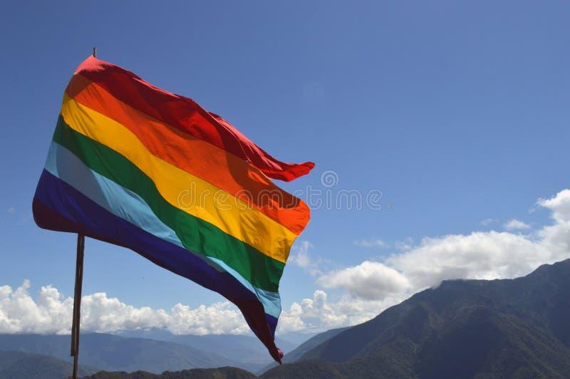 Die Flagge auf die Oberseite lizenzfreies stockbild
