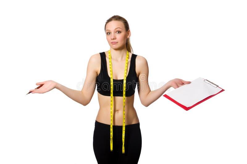 Die Frau im Sportkonzept lizenzfreie stockbilder
