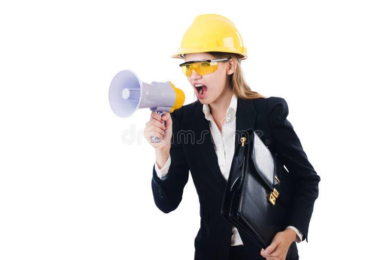 Die Frau mit dem Schutzhelm lokalisiert auf Weiß stockfotografie