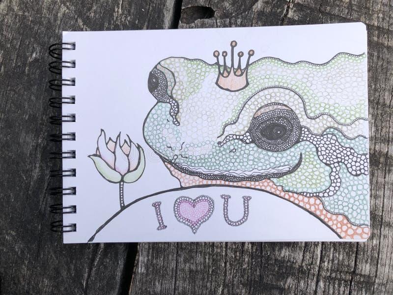 Die Froschprinzessin mit rosa Lotus, signe ich liebe dich, auf dem Holz lizenzfreie stockbilder