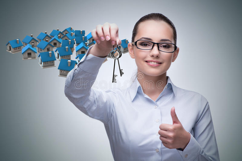 Die Geschäftsfrau im Konzept der Hypothek stockfotografie