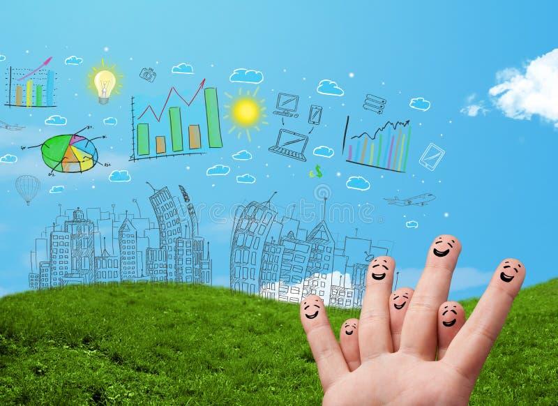 Die glücklichen smileyfinger, die gezeichnete städtische Stadt zur Hand schauen, gestalten landschaftlich stockfoto