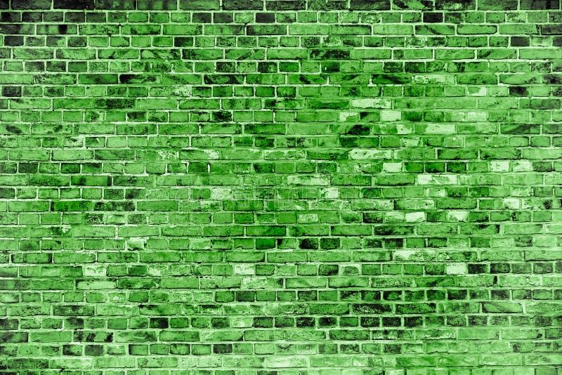 Die grüne Backsteinmauer, die mit verschiedenen Tönen gemalt werden und die Farben des Grüns als nahtloses Muster masern Hintergr lizenzfreie stockbilder