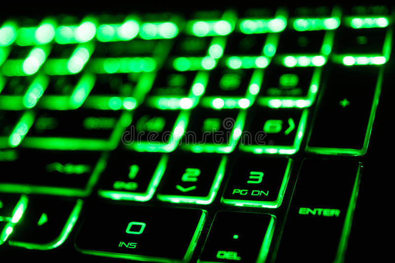 die grüne Leuchtstoffcomputertastatur stockbilder
