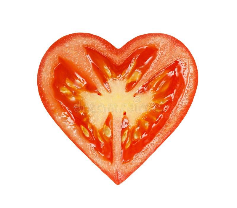 Die Hälfte der Tomaten in Form von Herzen lizenzfreie stockfotografie