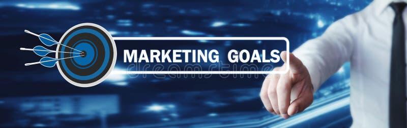 Die Hand, die auf Marketing-Zielen sich berührt, simsen mit einem Zielpfeil stockfoto