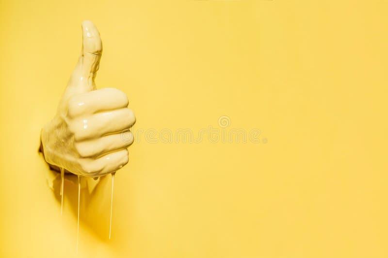 Die Hand, die das ` zeigt, mögen ` Zeichen stockbild