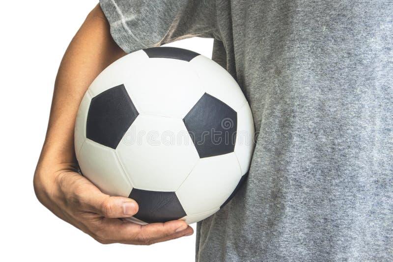 Die Hand hält den Ball an der Taille stockfotos