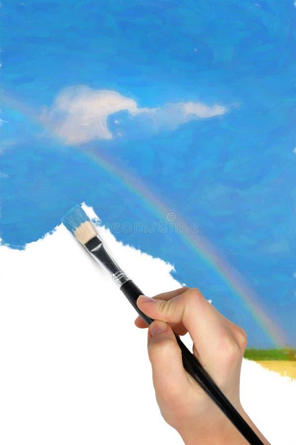 Die Hand mit einem Pinsel zeichnet eine Landschaft stockfoto