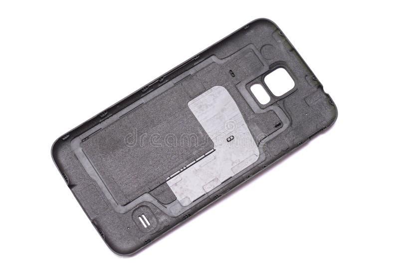 Die innere Seite eines schwarzen Smartphonerückendeckels stockfoto