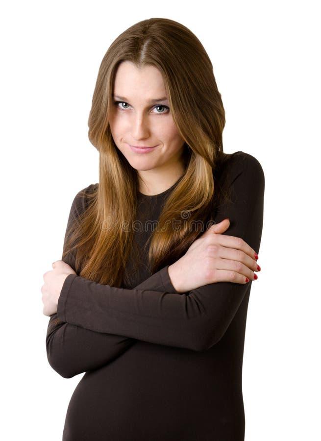 Junge Frau in der braunen Strickjacke stockbild