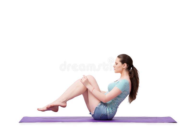 Die junge Frau im Sportkonzept lokalisiert auf dem Weiß lizenzfreie stockfotografie
