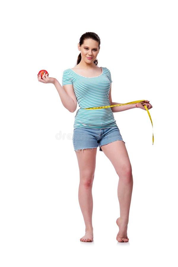 Die junge Frau im Sportkonzept lokalisiert auf dem Weiß lizenzfreie stockfotos
