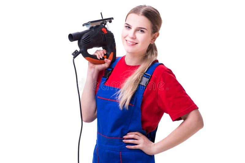 Die junge Frau mit der Energiesäge lokalisiert auf Weiß stockbilder