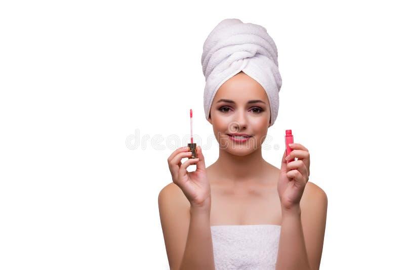 Die junge Schönheit mit Lippenstift auf Weiß stockfoto