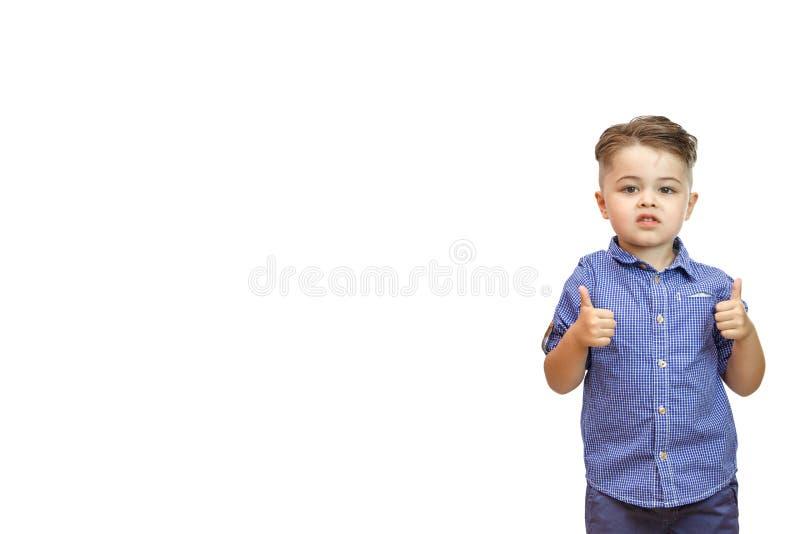 Die Jungen ?bergeben zeigt eine Geste der Zustimmung Daumen oben Die Hand zeigt Gestenklasse Alles ist, Sie werden getan, Lob küh lizenzfreie stockfotos