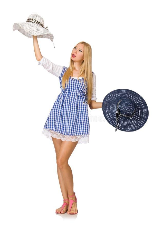 Die kaukasische Frau in im blauen Kleid und dem Hut des Plaids auf Weiß stockbild