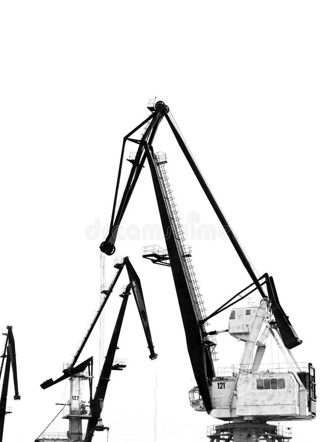 Die Konturen der Kräne des alten Hafens lokalisiert auf weißem Hintergrund lizenzfreie stockbilder