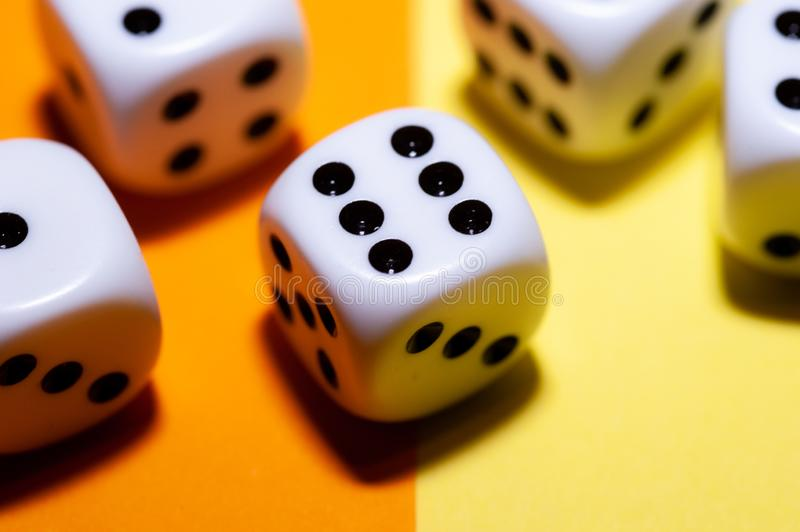 Die macro with number six showing. Macro of a die, showing the number six. in the background four other dice are blurred royalty free stock image