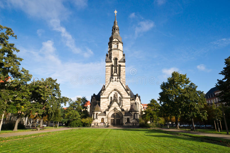 Die Michaeliskirche in Leipzig. View of the Michaeliskirche in Leipzig/Germany suurounded by a little park. The 70m high building shows architectonic elements of stock image