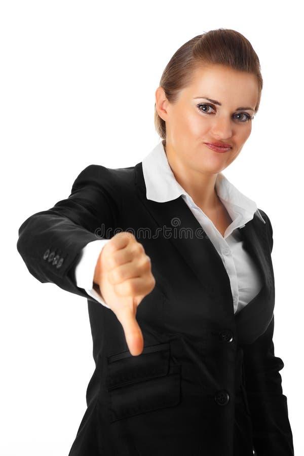 Die moderne Geschäftsfrau, die Daumen gestikulieren zeigt unten lizenzfreie stockfotografie