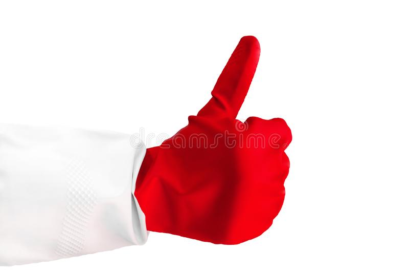 Die Nahaufnahmeansichthand, die einen Gummihandschuh trägt, gibt Daumen von einer Hand auf, die wie Geste macht als Zeichen des E lizenzfreies stockbild