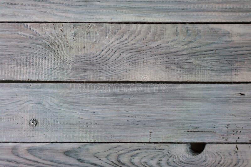 Die Oberfläche der rauen Planken malte helle Farbe lizenzfreies stockbild