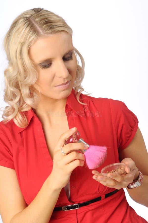 Die schöne blonde junge Frau lizenzfreie stockfotos