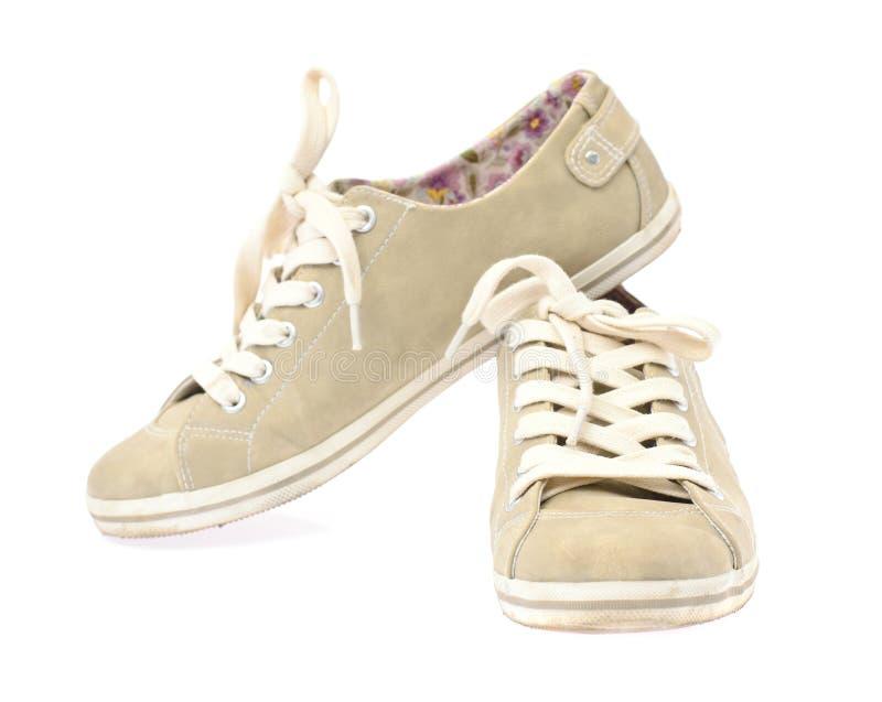 Die Schuhe der Frauen lokalisiert auf weißem Hintergrund stockbild