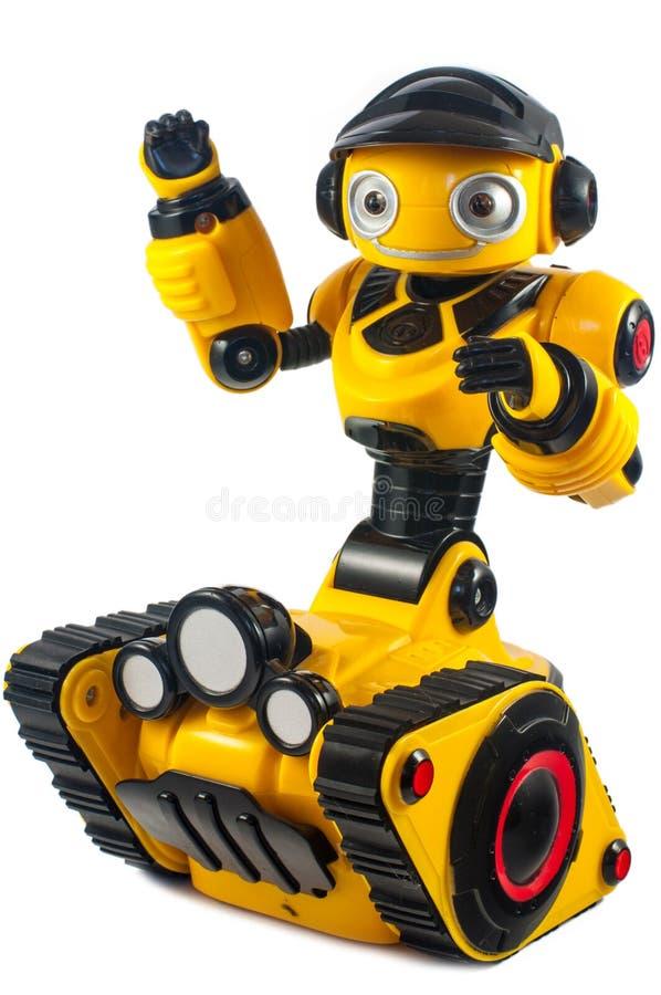 Die Spielwaren der Kinder - gelber Roboter auf Gleiskettenfahrzeug dreht sich stockfotografie