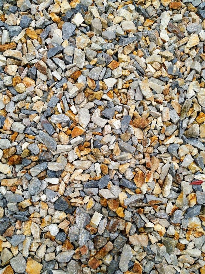 Die Steine sind mehrfarbig, Hintergrund und Beschaffenheit für Bilder lizenzfreies stockbild