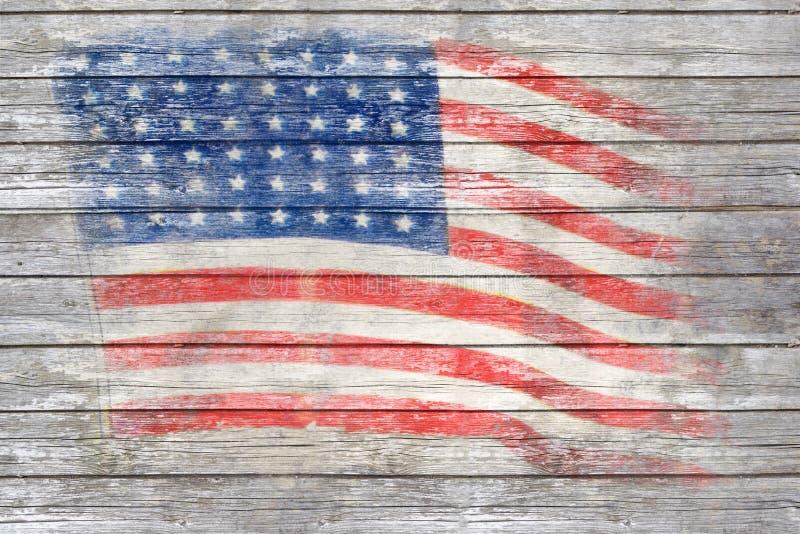 Die USA-Flagge gemalt auf Holzoberfläche stockbild