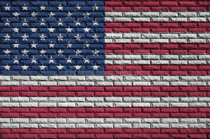 Die Vereinigten Staaten von Amerika kennzeichnen werden gemalt auf eine alte Backsteinmauer lizenzfreie abbildung
