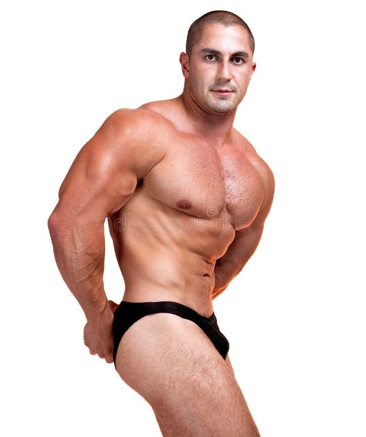 Die vollkommene muskulöse Mannaufstellung lizenzfreie stockfotografie