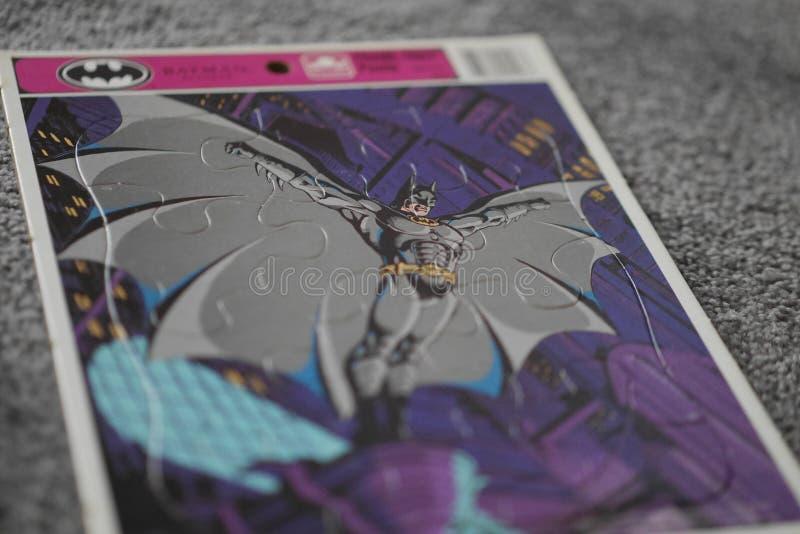 Die Weinlese-Batman-Puzzlespiel des Kindes lizenzfreie stockfotos