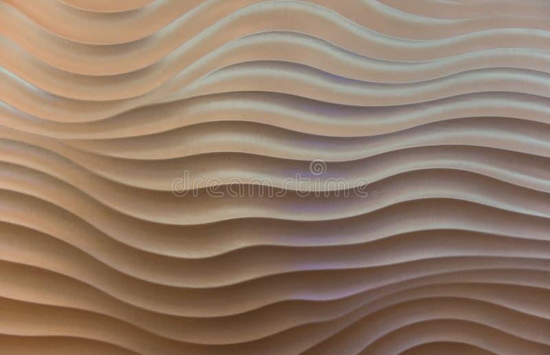 Die Wellenmusterbetonmauer stockbilder