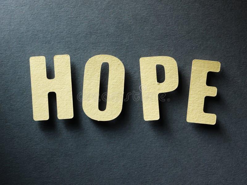 Die Wort Hoffnung auf Papierhintergrund lizenzfreie stockfotografie